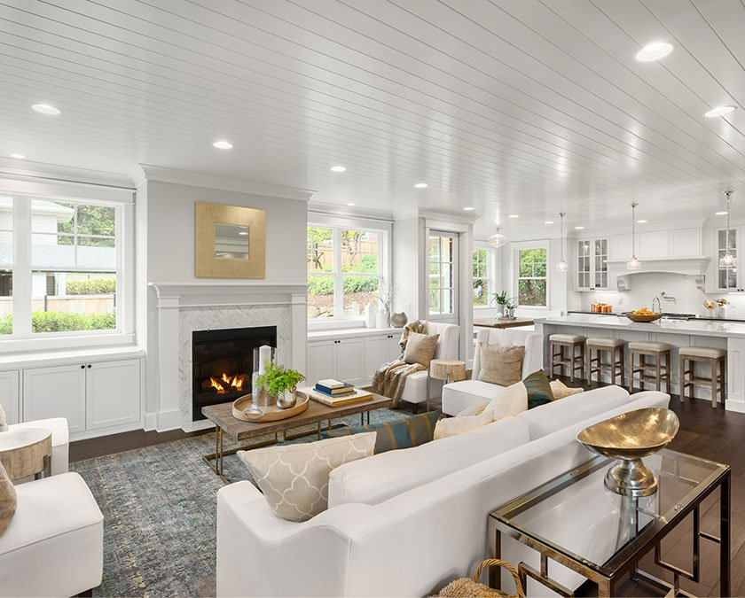 Open space addition with living room with chimney and modern kitchen